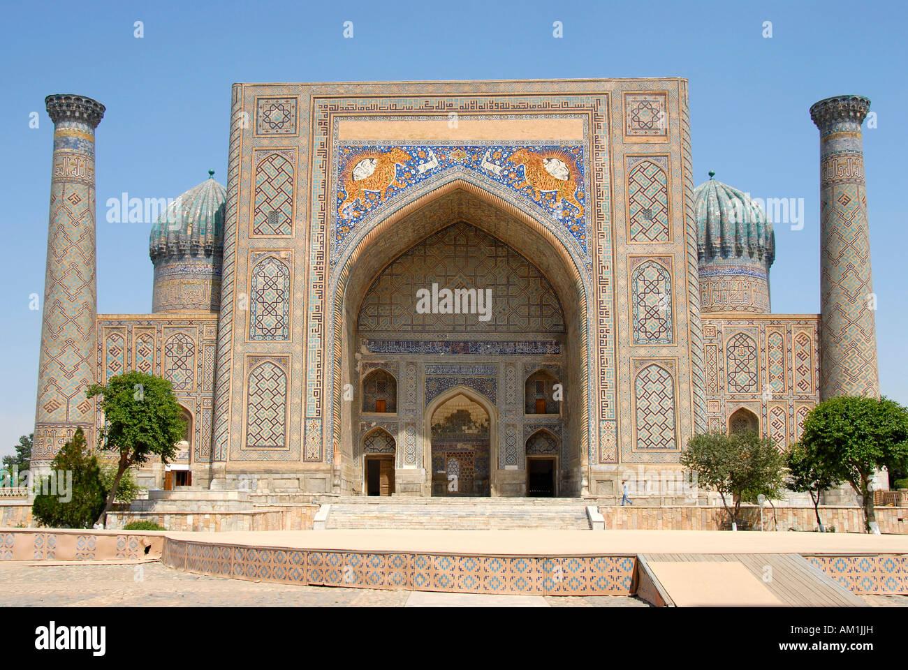 Iwan, minarets and cupolas Madrasah Sherdar Registan Samarkand Uzbekistan Stock Photo