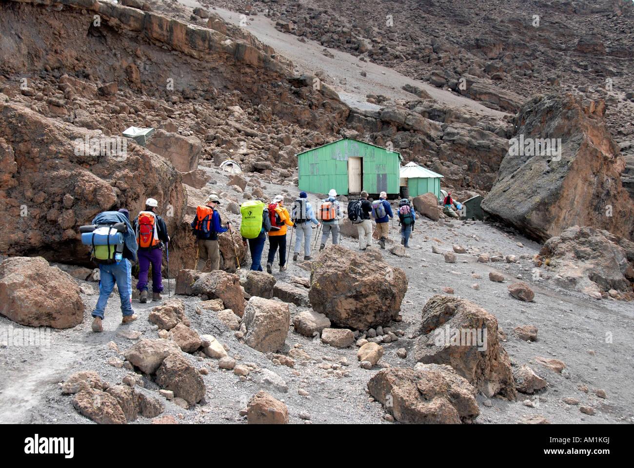 Group of trekkers on their way to School Hut Kikelewa Route Kilimanjaro Tanzania - Stock Image