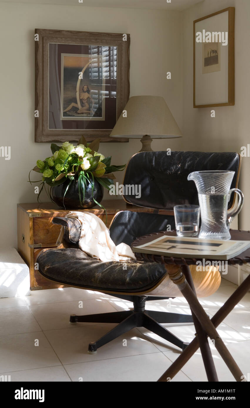 Leather armchair and campaign table in London apartment - Stock Image