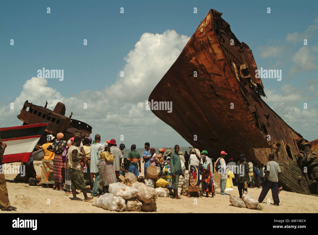 An old rusty tanker shipwreck on the beach of Beira. Mozambique, Southern Africa - Stock Image