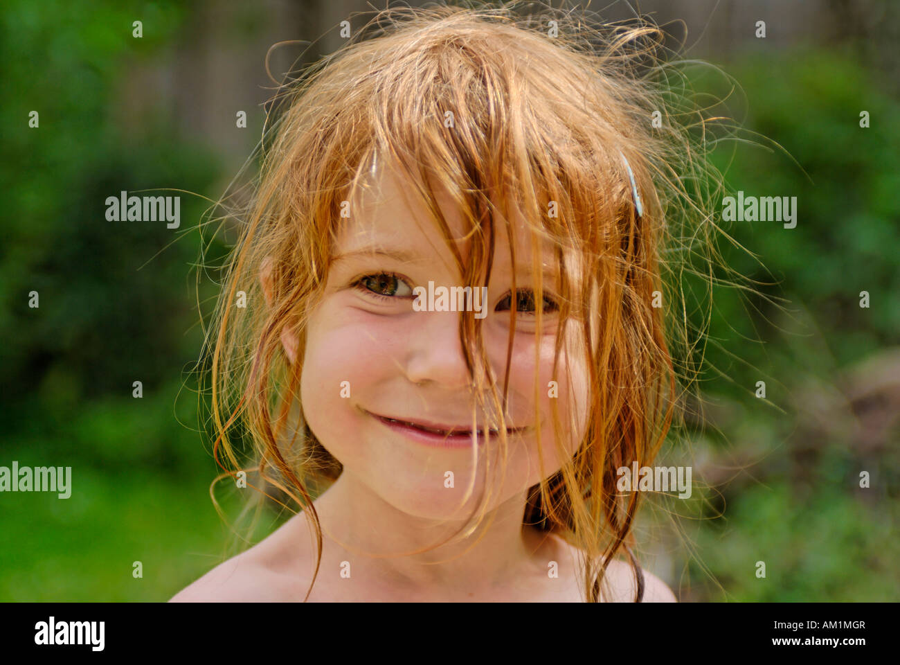Little girl with wild wet hair - Stock Image