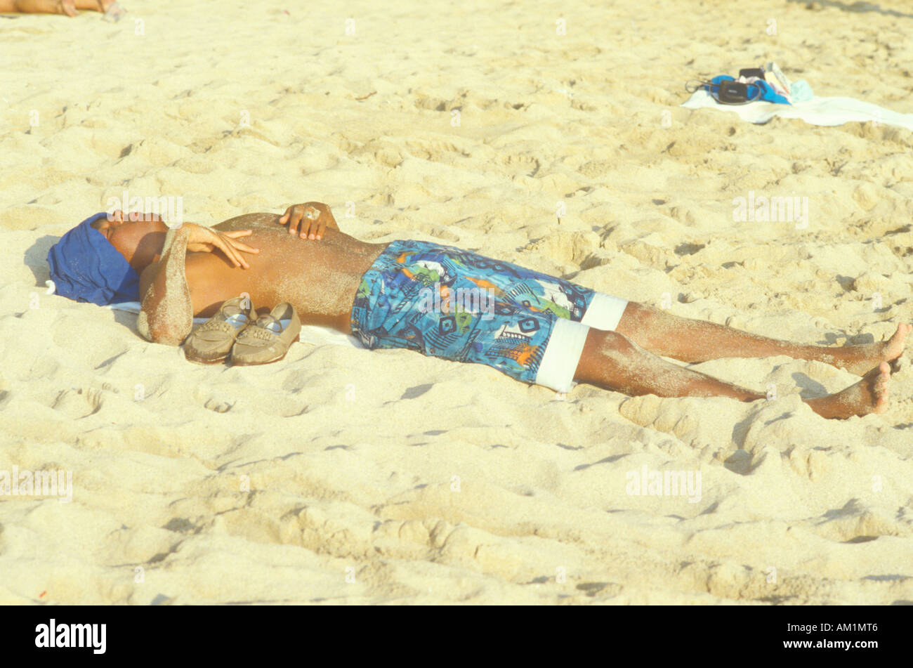 Sun Bather Kauai HI - Stock Image
