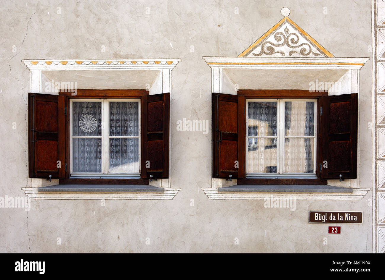 Windows of an Engadine house decorated with Sgraffito ornaments, Samedan, Engadin, Grisons, Switzerland Stock Photo