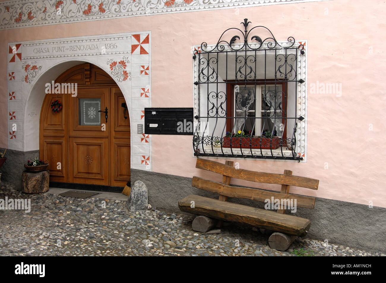 Entrance of an Engadin house decorated with Sgraffito ornaments, Scuol, Schuls, Lower Engadin, Grisons, Switzerland Stock Photo