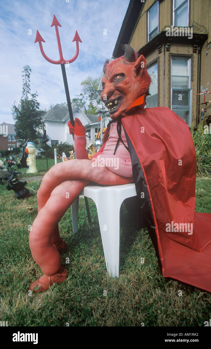 Dummy Dressed as the Devil for Halloween on Front Lawn Illinois - Stock Image
