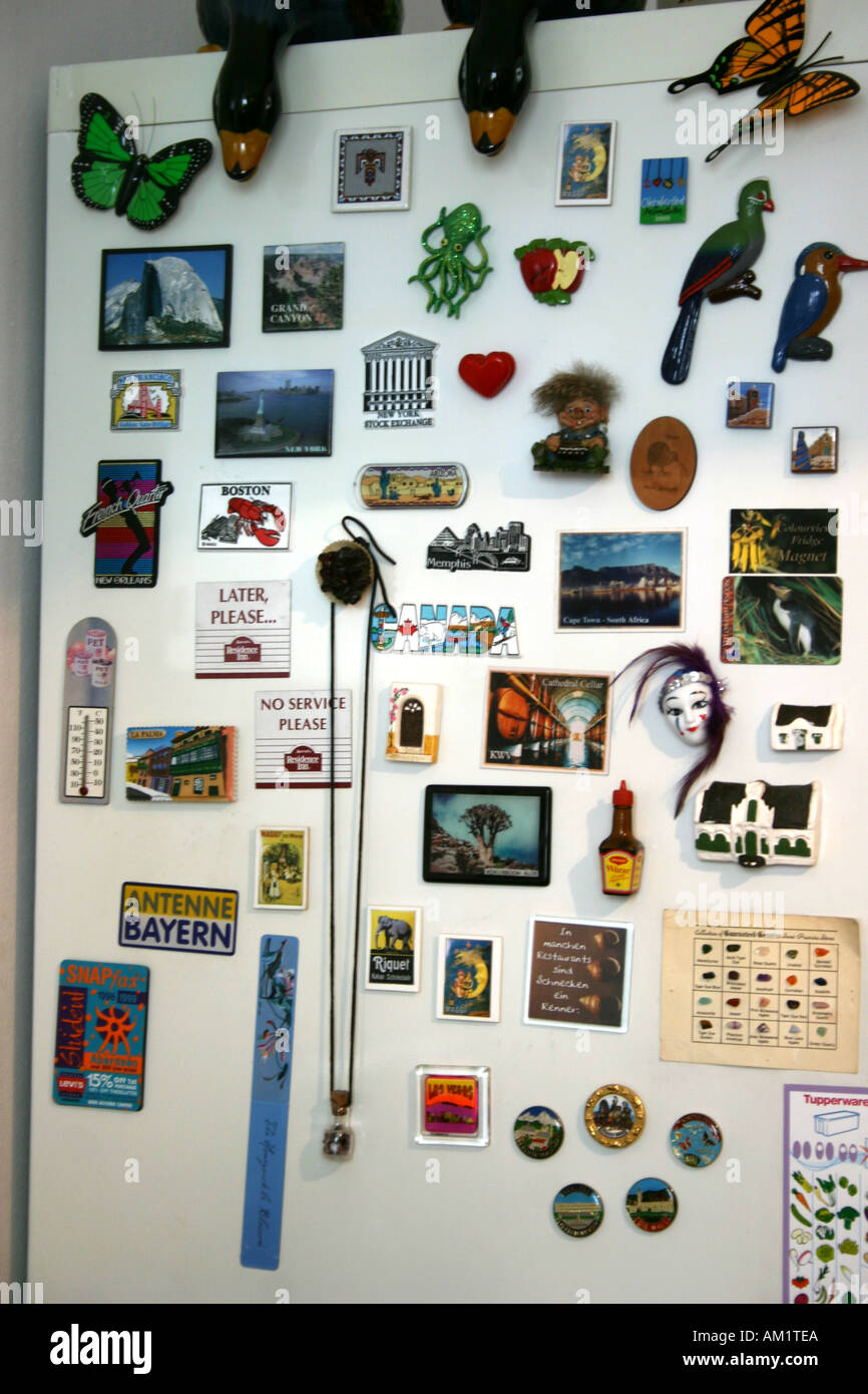A refrigerator door with multiple magnets and art - Stock Image