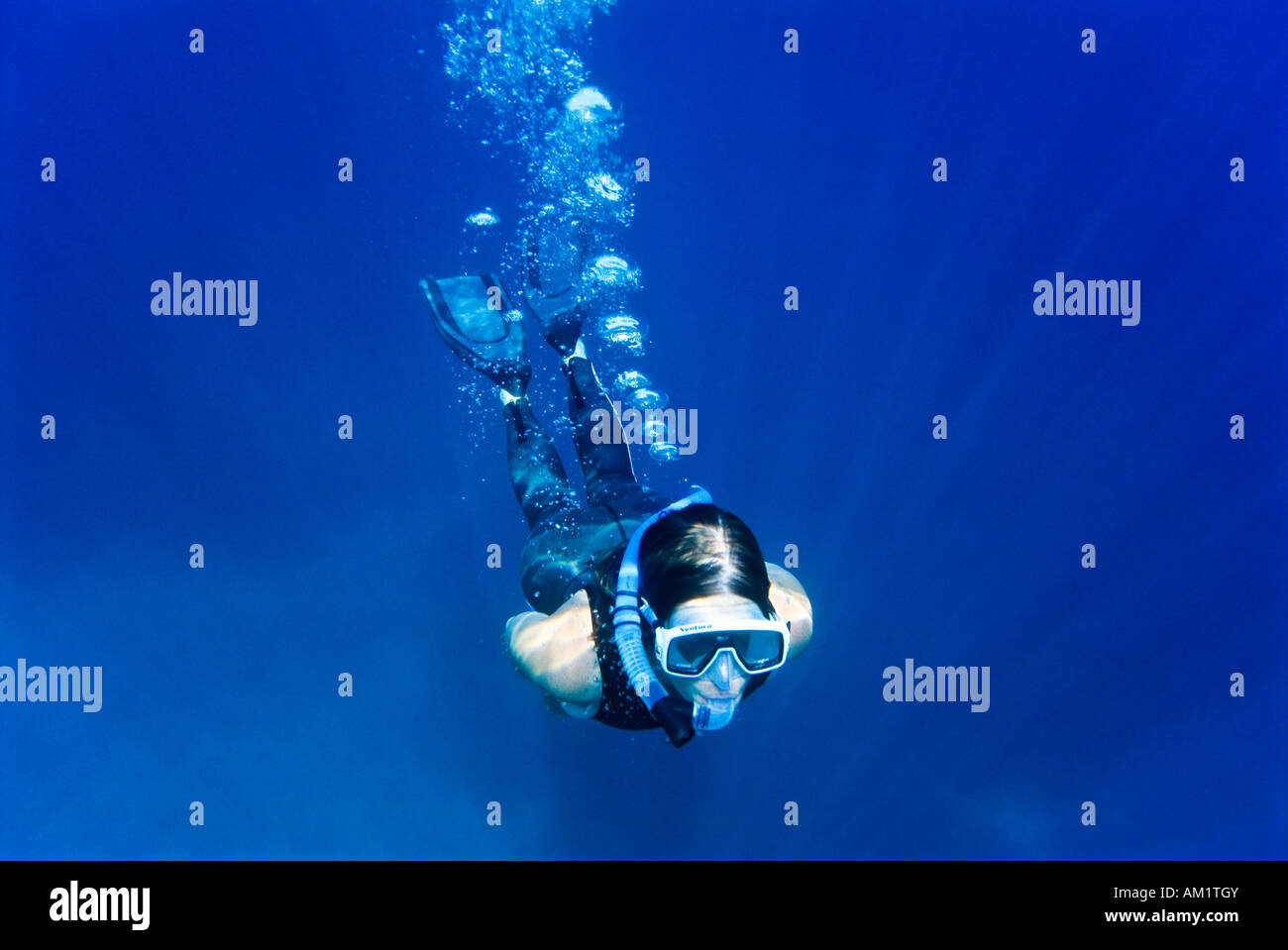 Woman snorkeling, Crete, Greece - Stock Image