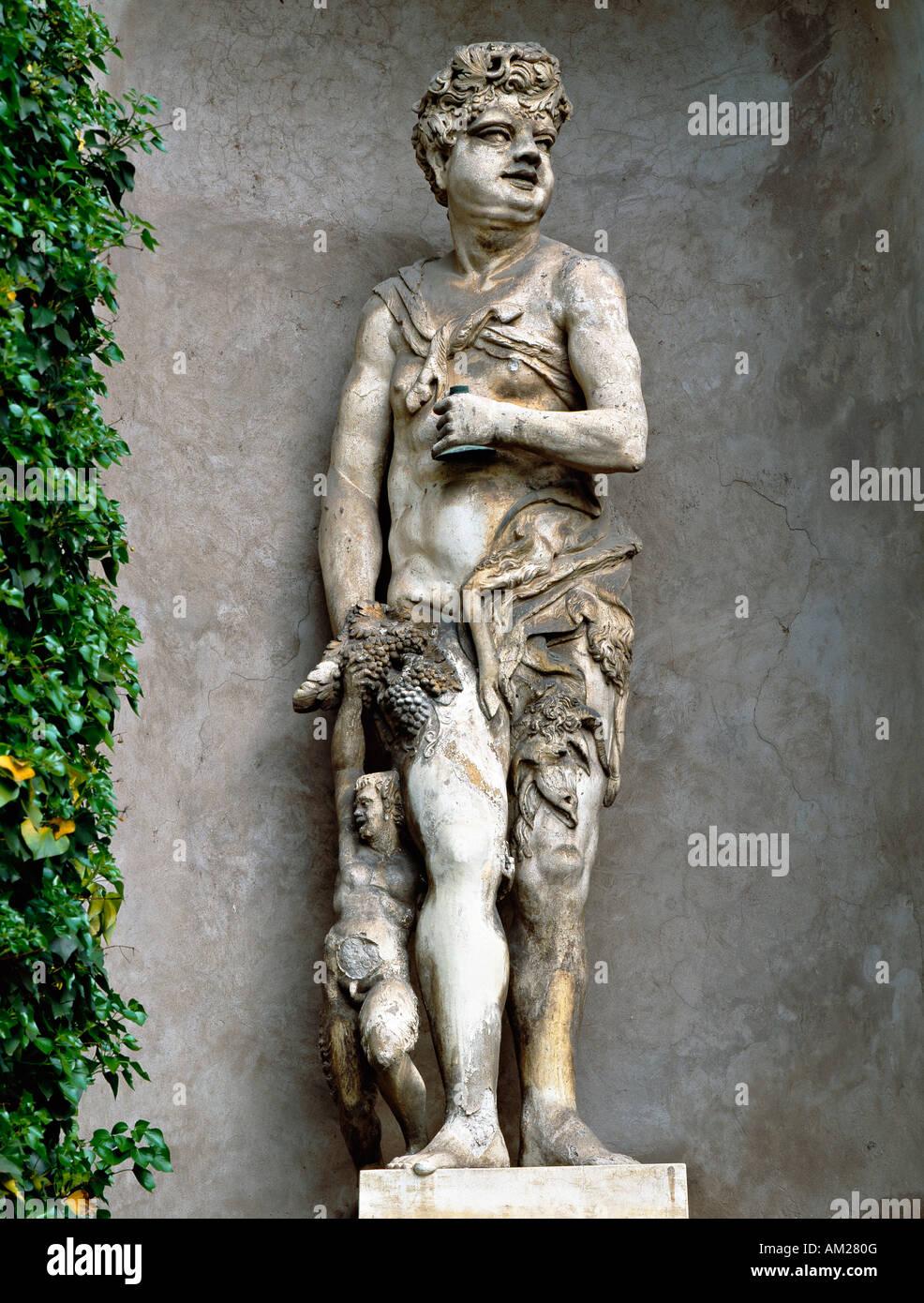 The Renaissance gardens of the Giardino Giusti, Verona, Italy. Statue of the Roman god Bacchus - Stock Image