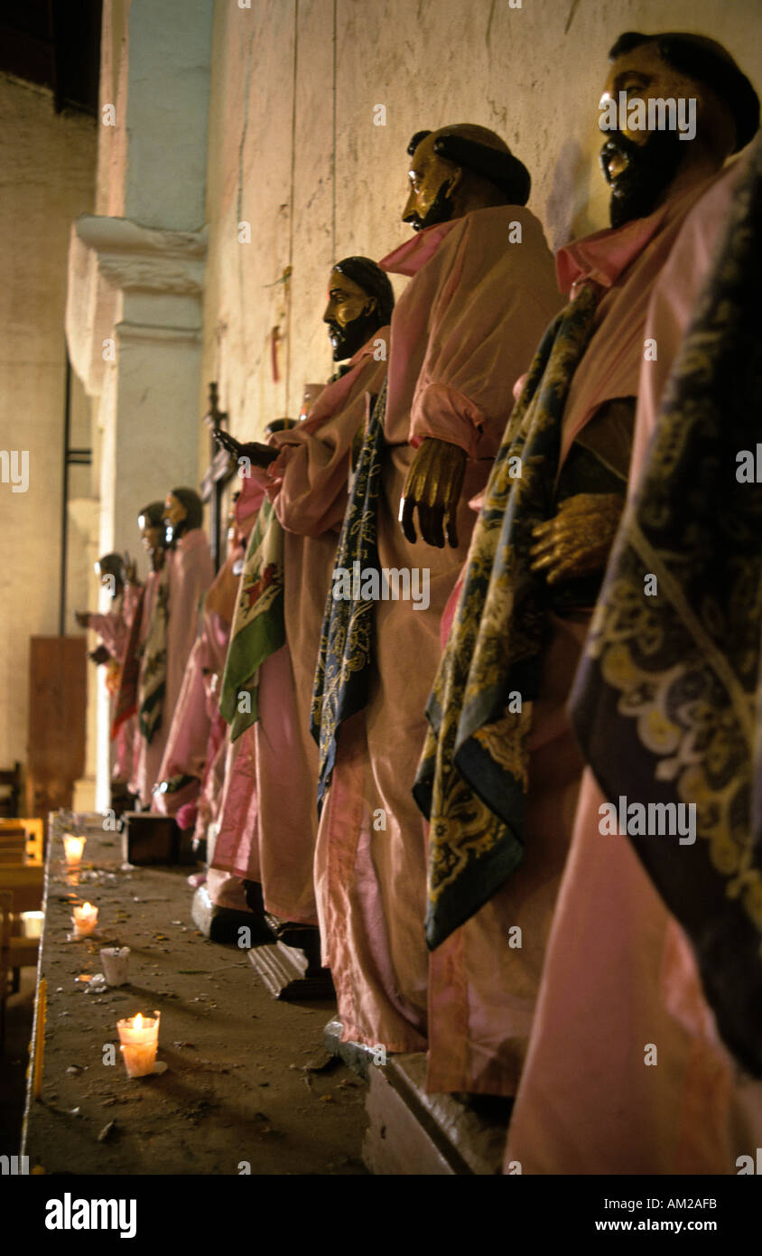 Saints statues line the walls of the Catholic church Santiago Atitlan Guatemala - Stock Image