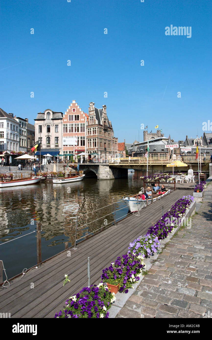 Excursion Boats at Graslei looking across to Korenlei in the city centre, Ghent, Belgium - Stock Image