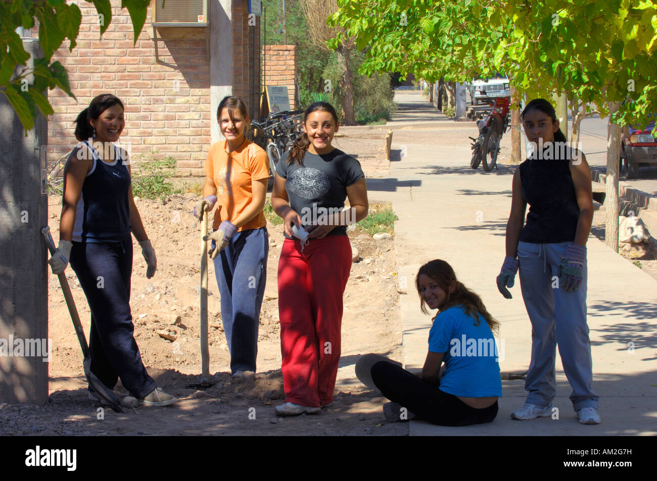 Young women taking a rest from manual labour exertions in Barreal - Stock Image