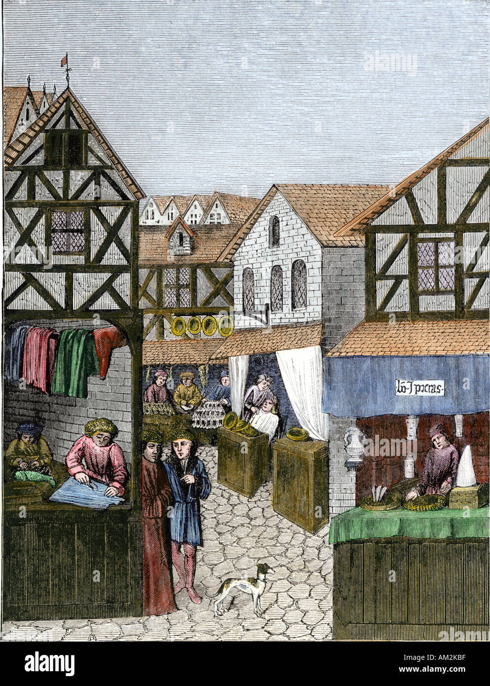 Shops in a medieval apothecary street showing a barber furrier and tailor France 1400s. Hand-colored woodcut Stock Photo