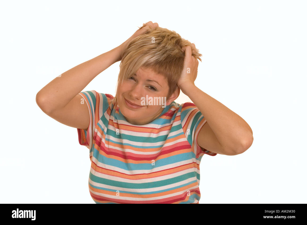 Girl tearing hair out in frustration - Stock Image