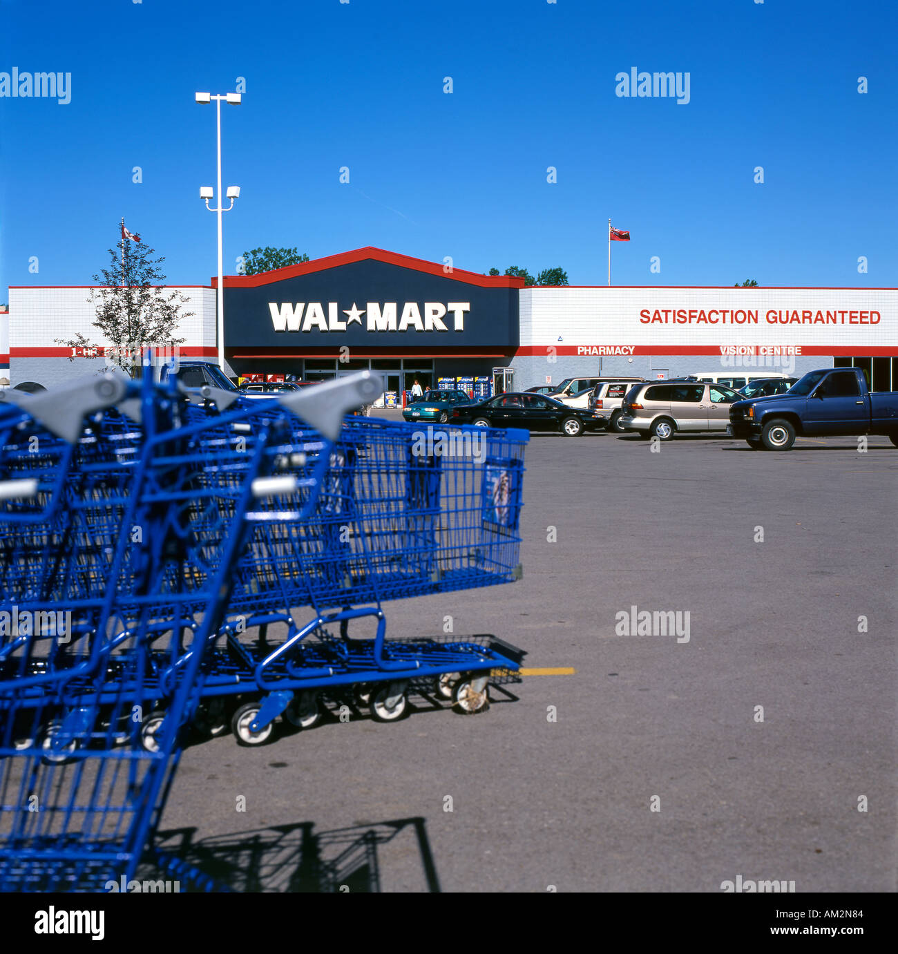 Blue Shopping Carts In A Walmart Store Parking Lot North