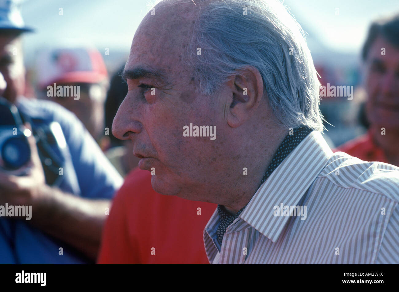 A famous Argentines Italian car driver Fangio participates at the 35th Pebble Beach California Concours vintage car show ca 1985 - Stock Image