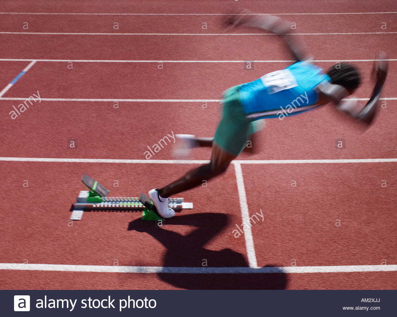 Racer at start line on track - Stock Image