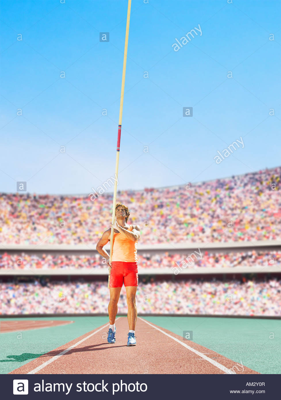 Athlete with pole vault in an arena - Stock Image