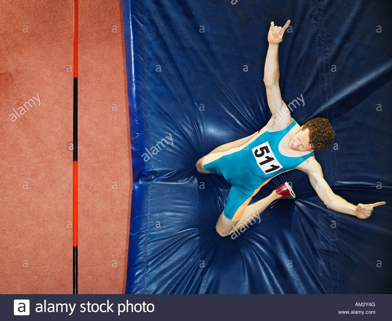 Athlete on a crash mat after high jumping - Stock Image