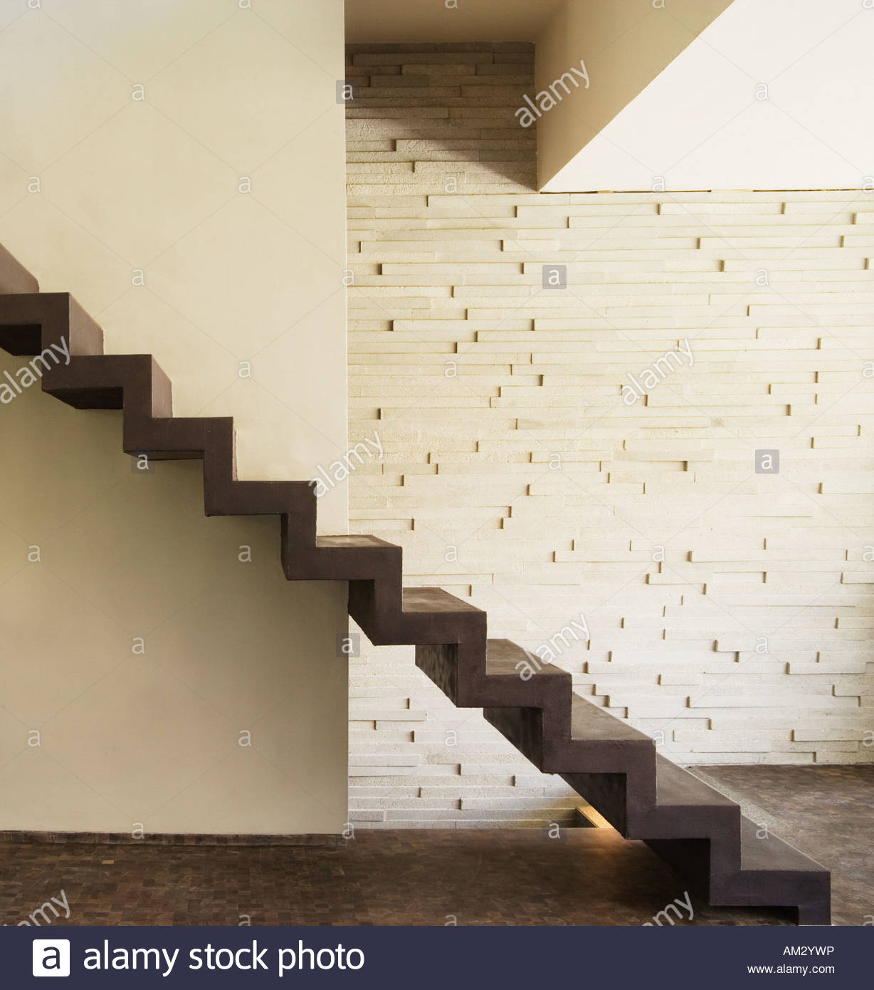 Modern stairs in front of wall - Stock Image