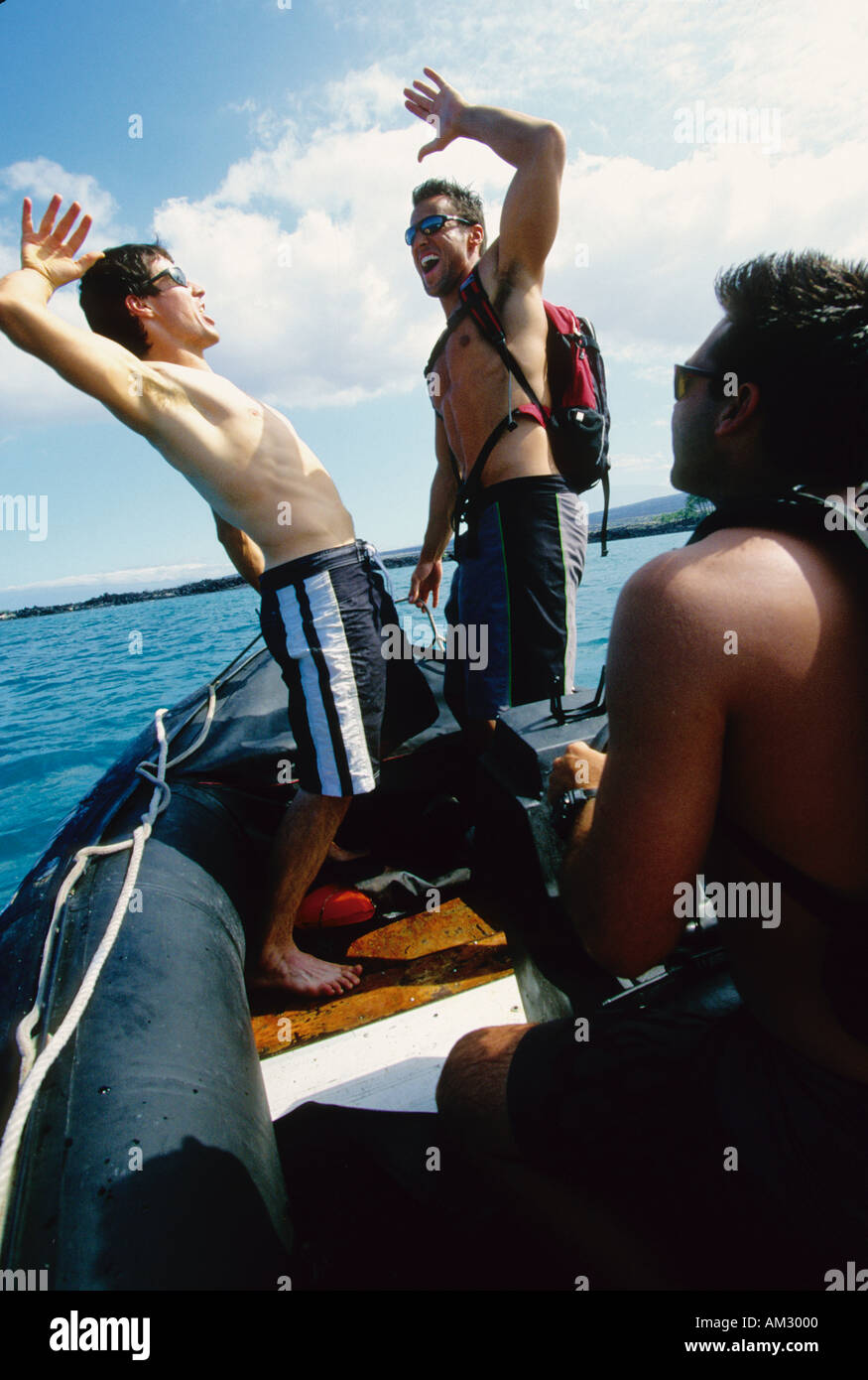 Men boating in an inflatable boat in Hawaii - Stock Image