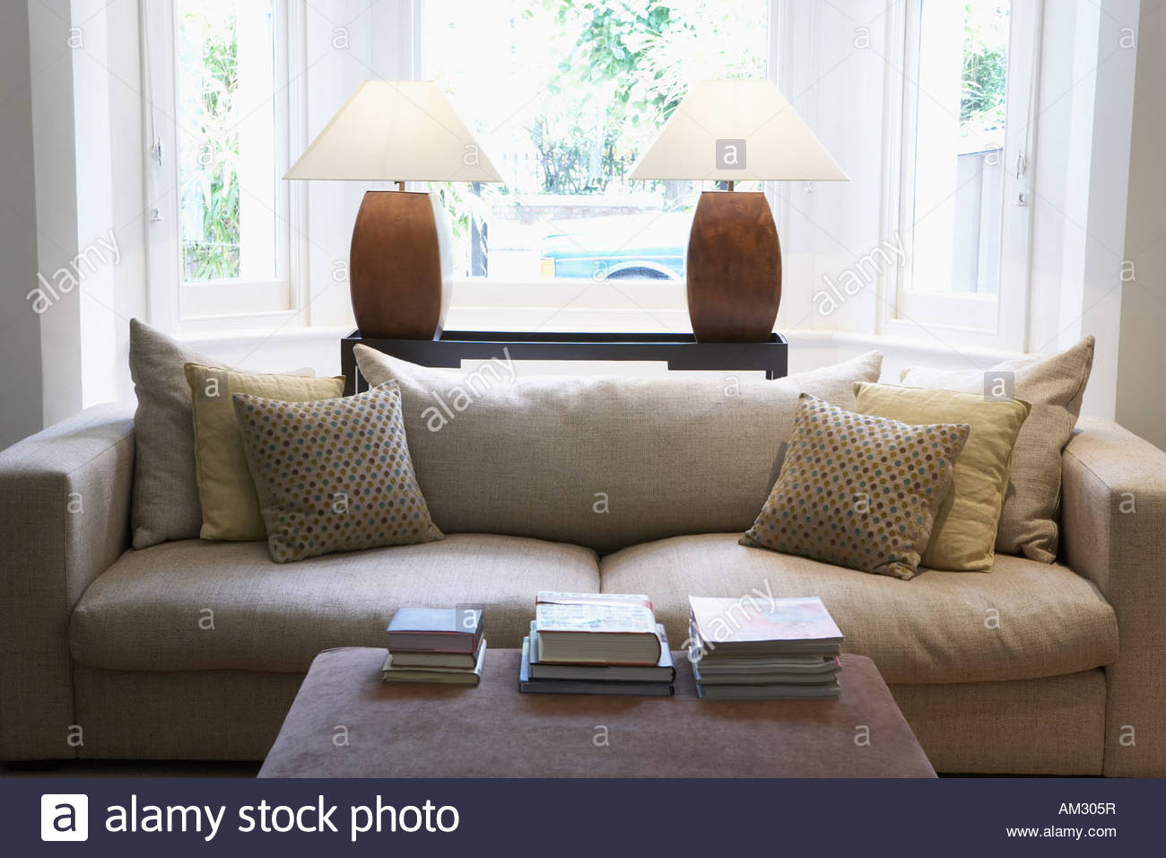 Empty living room with couch and coffee table - Stock Image