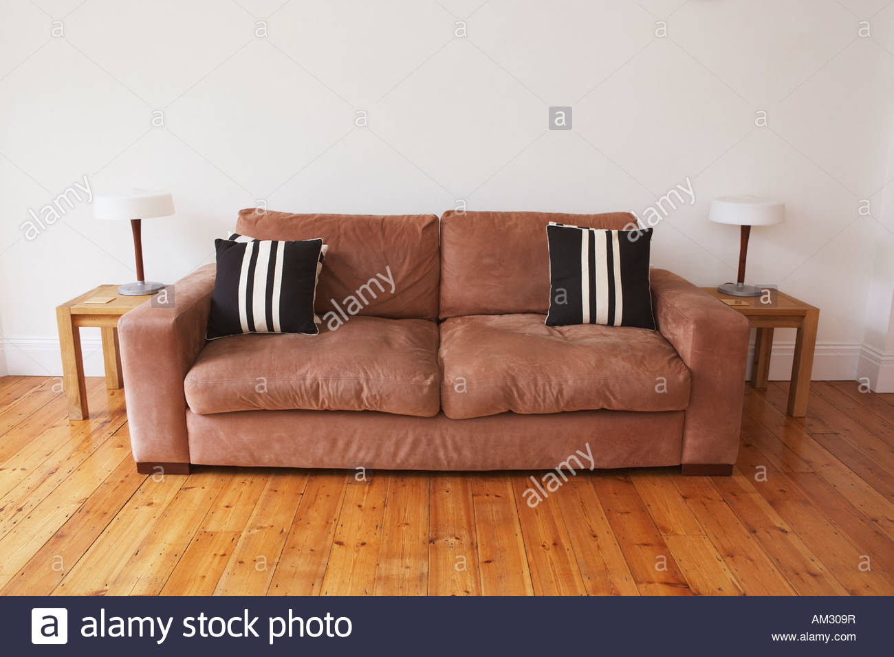 Empty living room with couch and end tables - Stock Image