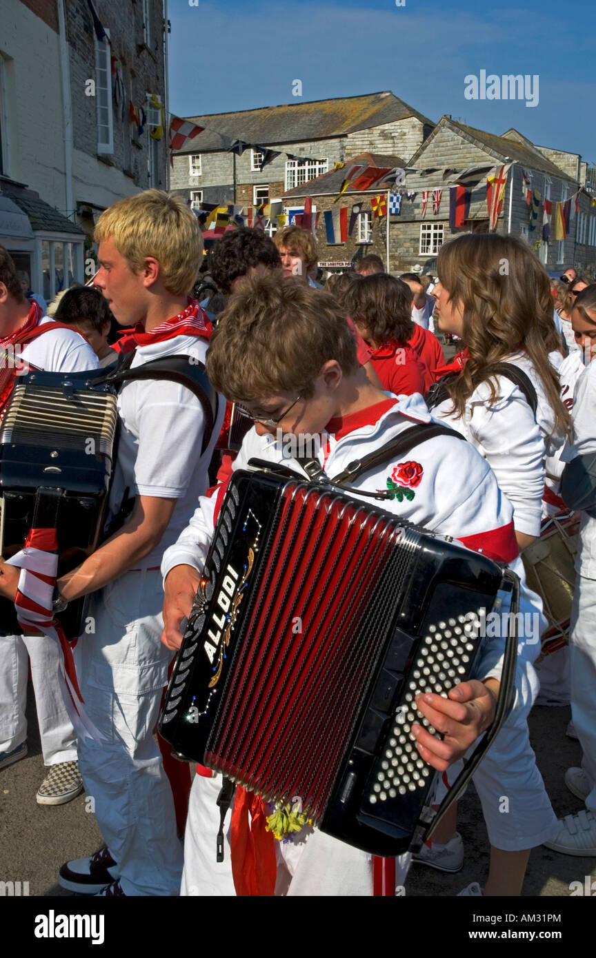 teenagers playing musical instruments on obby oss day in padstow,cornwall,england Stock Photo