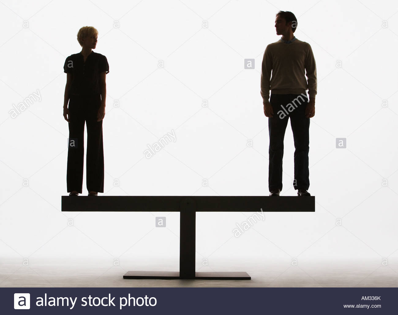 two people standing on top of a plank Stock Photo