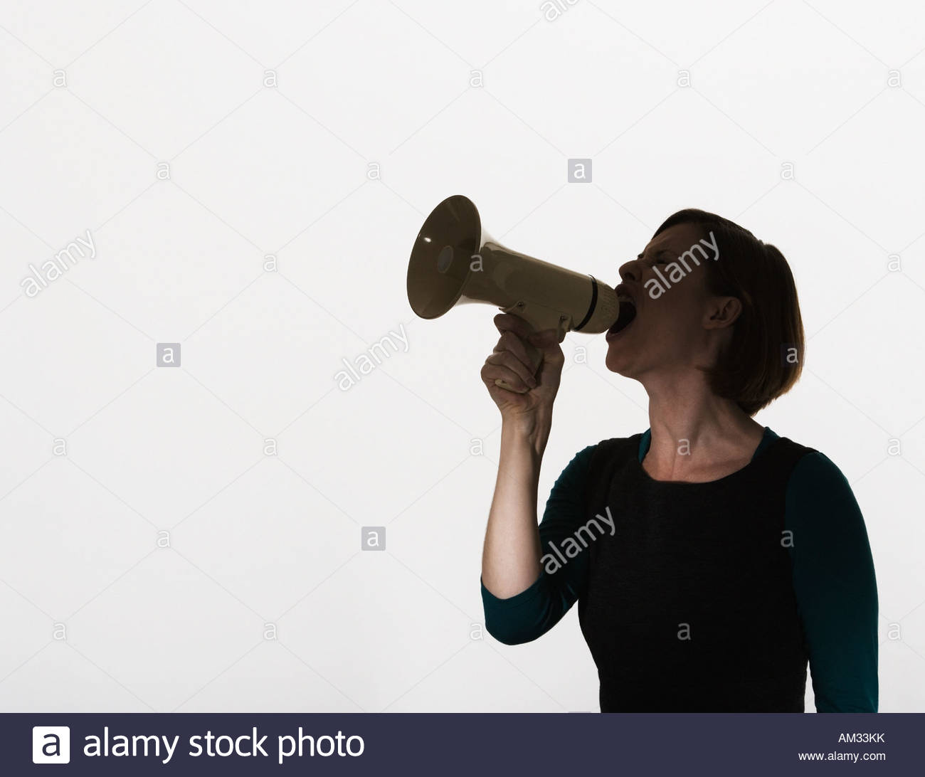 Woman shouting through a megaphone - Stock Image