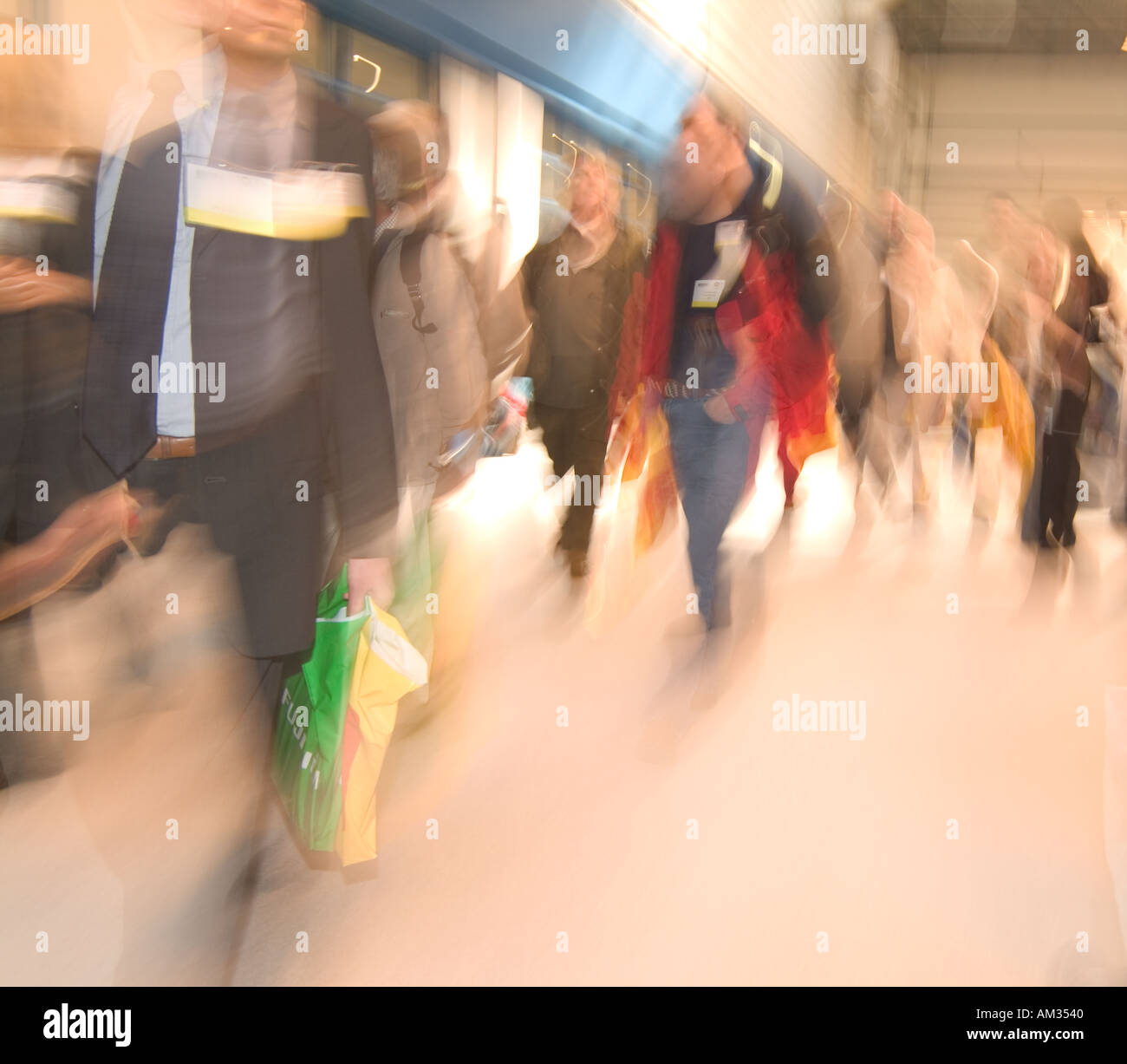 shoppers at trade show shop retail trade show customers commerce capitalist plastic bag capitism money sell sale economy econom - Stock Image