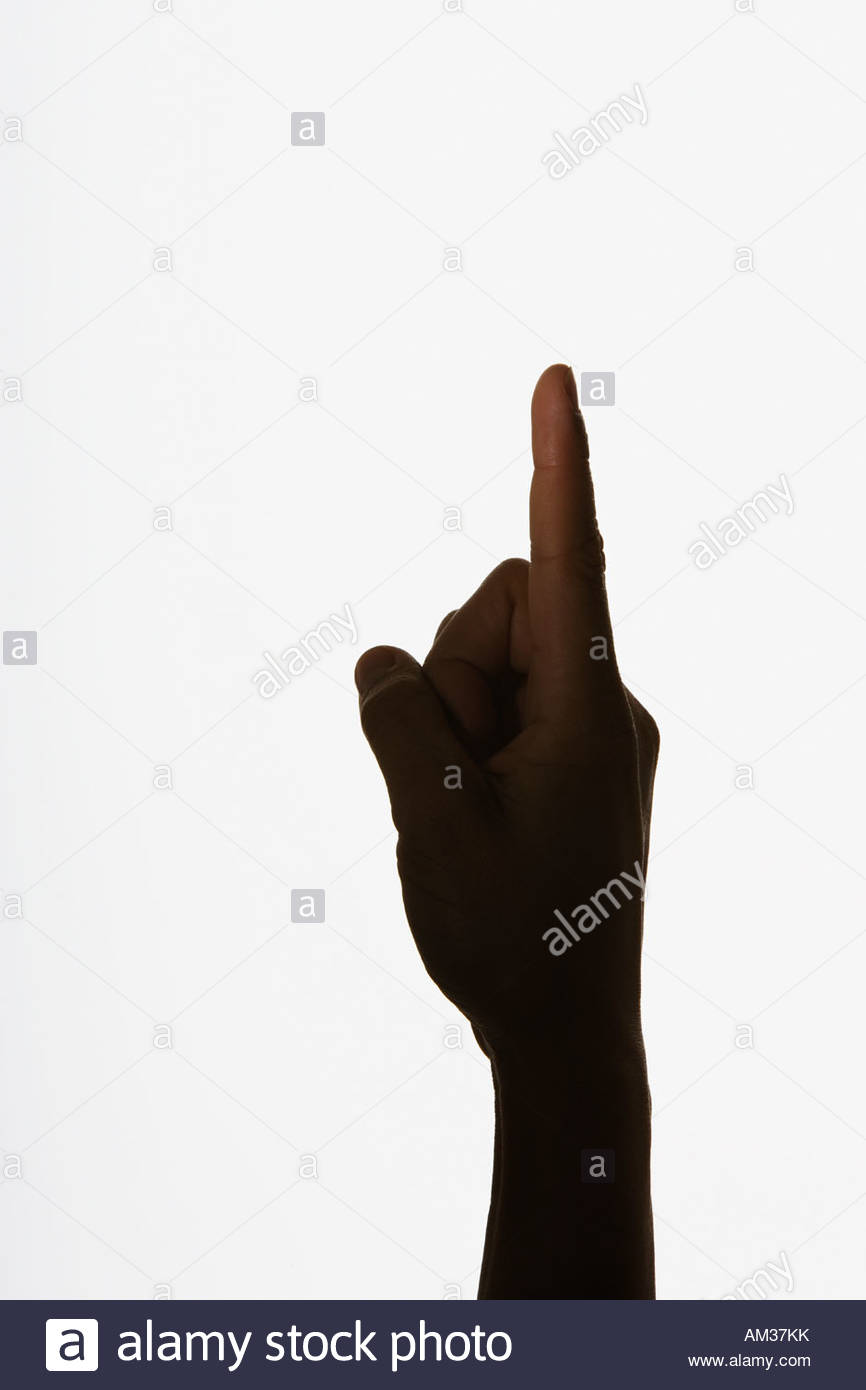 Hand with finger pointing straight up - Stock Image