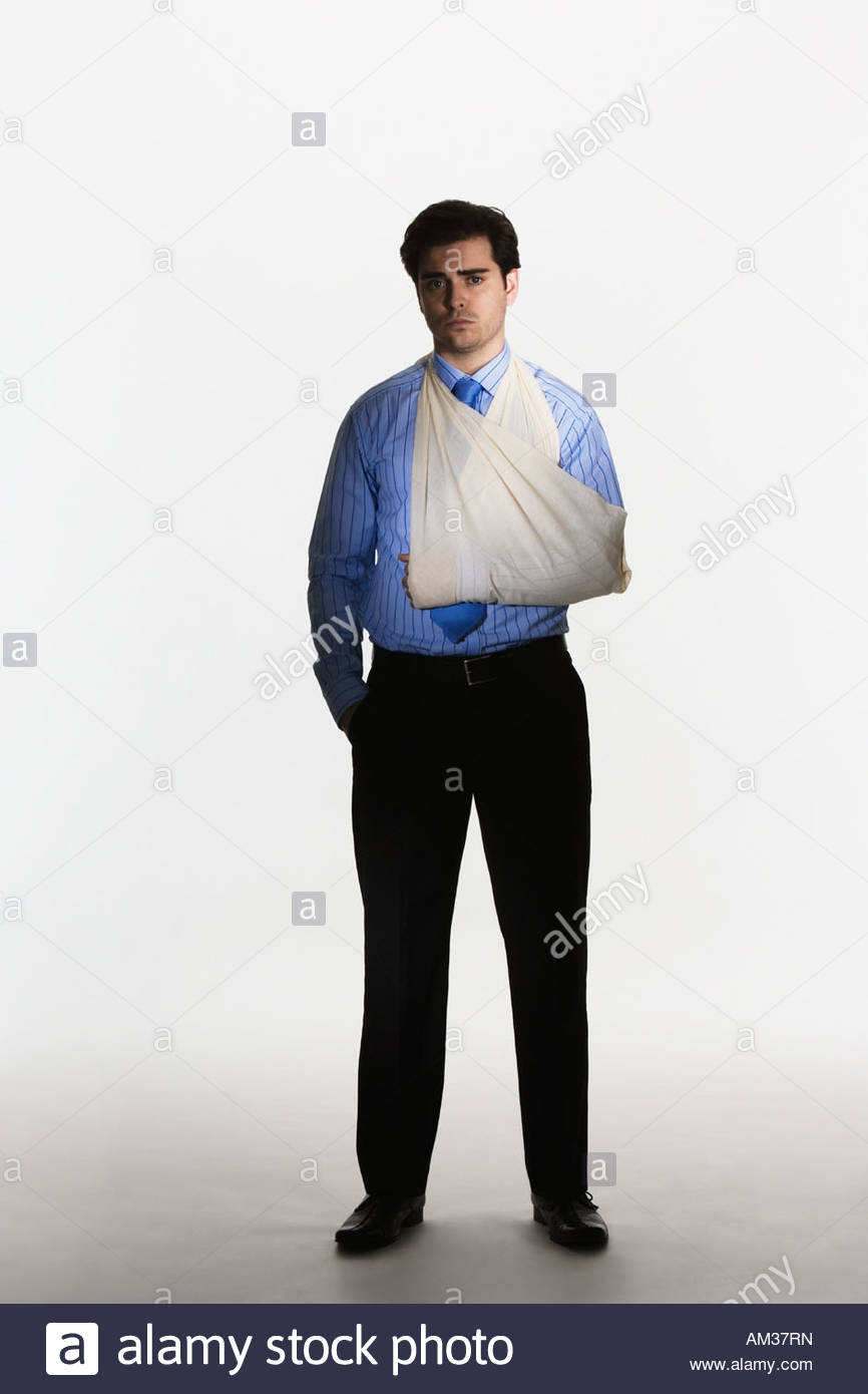 Man with broken arm in sling - Stock Image