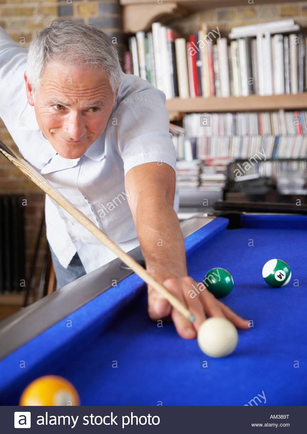 Man playing pool - Stock Image