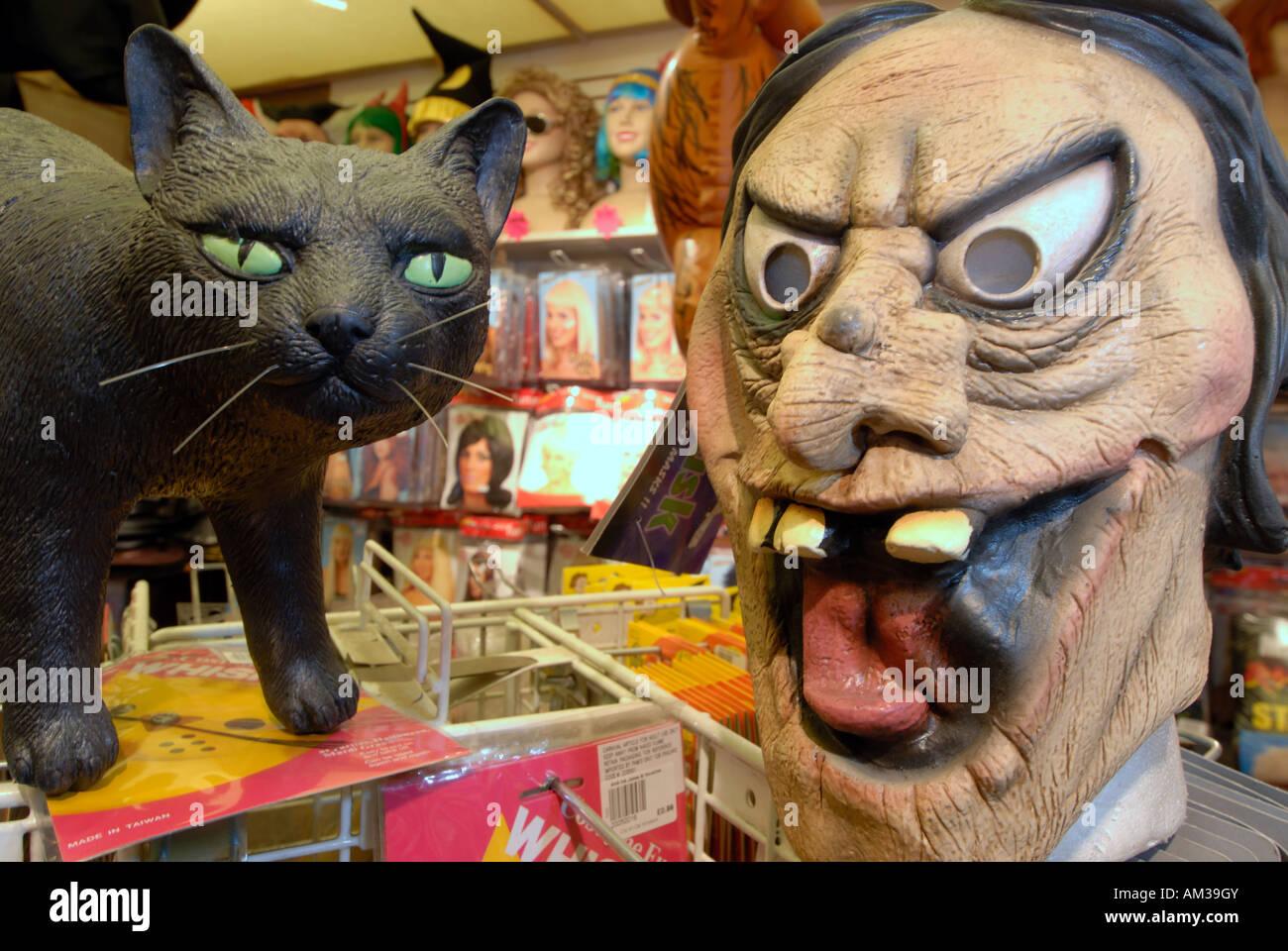 mask and a cat halloween party items at aha ha ha jokes & novelties shop in Edinburgh Scotland - Stock Image