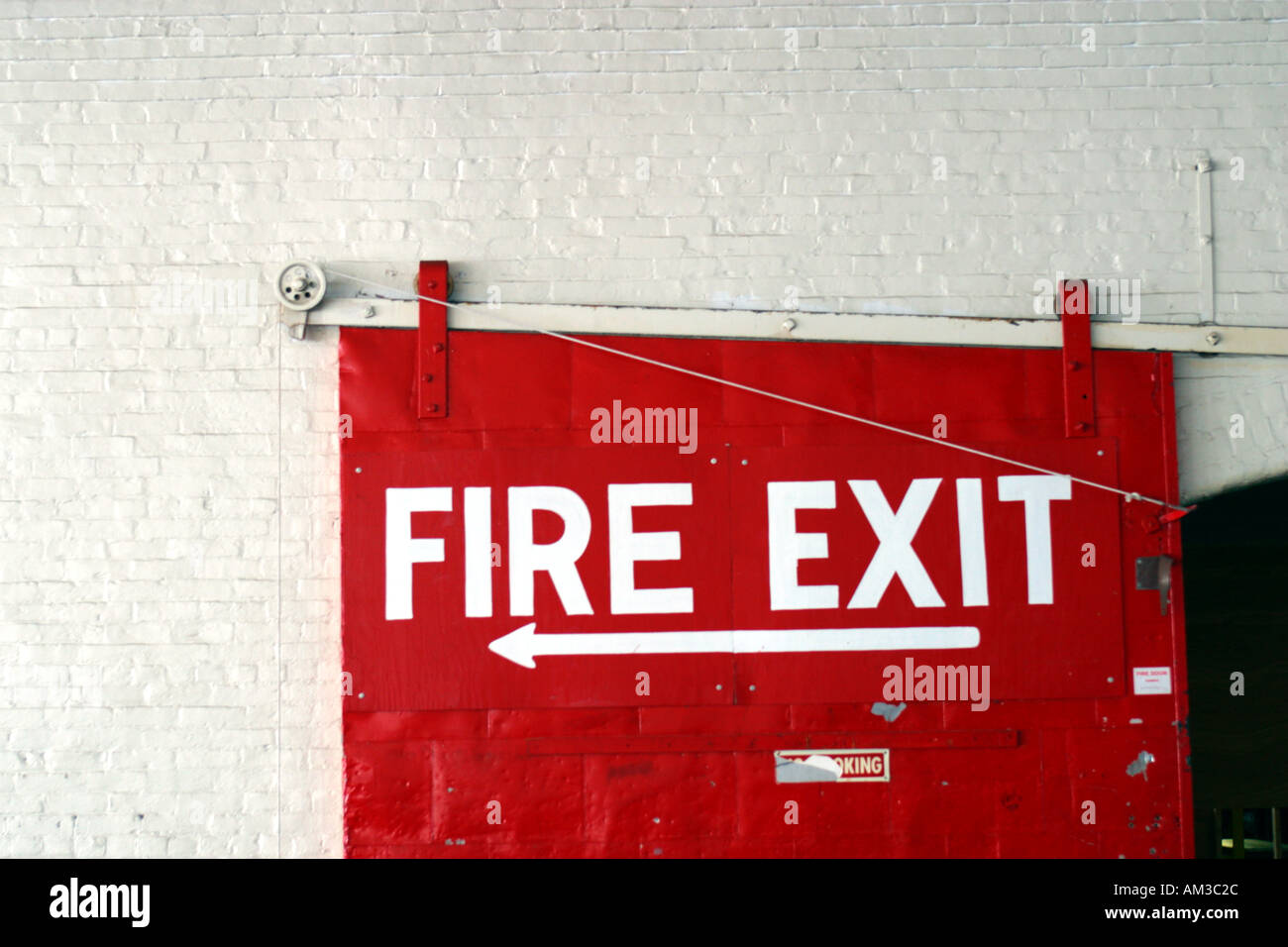 Exit Sign in Textile Manufacturing Facility Lawrence MA - Stock Image
