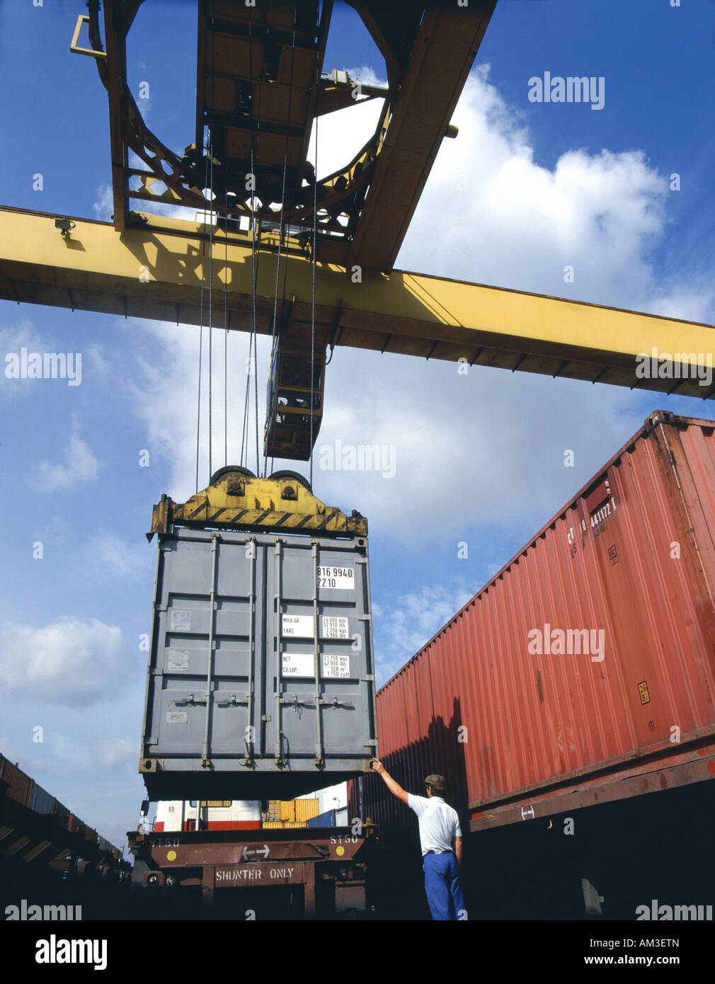Shipping container being loaded onto specialised lorry - Stock Image