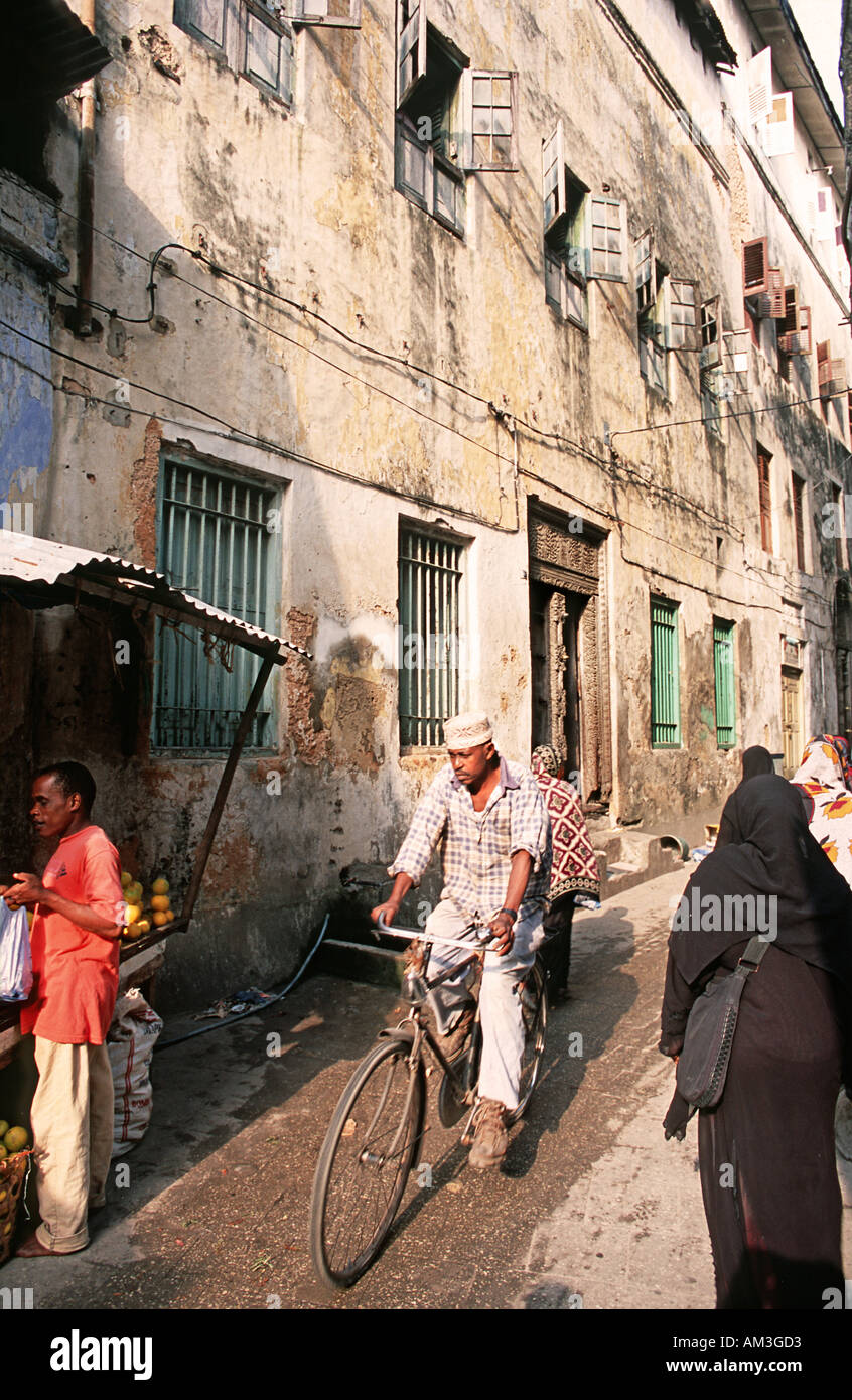 Old Stone Town is a warren of narrow streets Historic trading town Unguja Zanzibar Tanzania East Africa Busy street scene - Stock Image