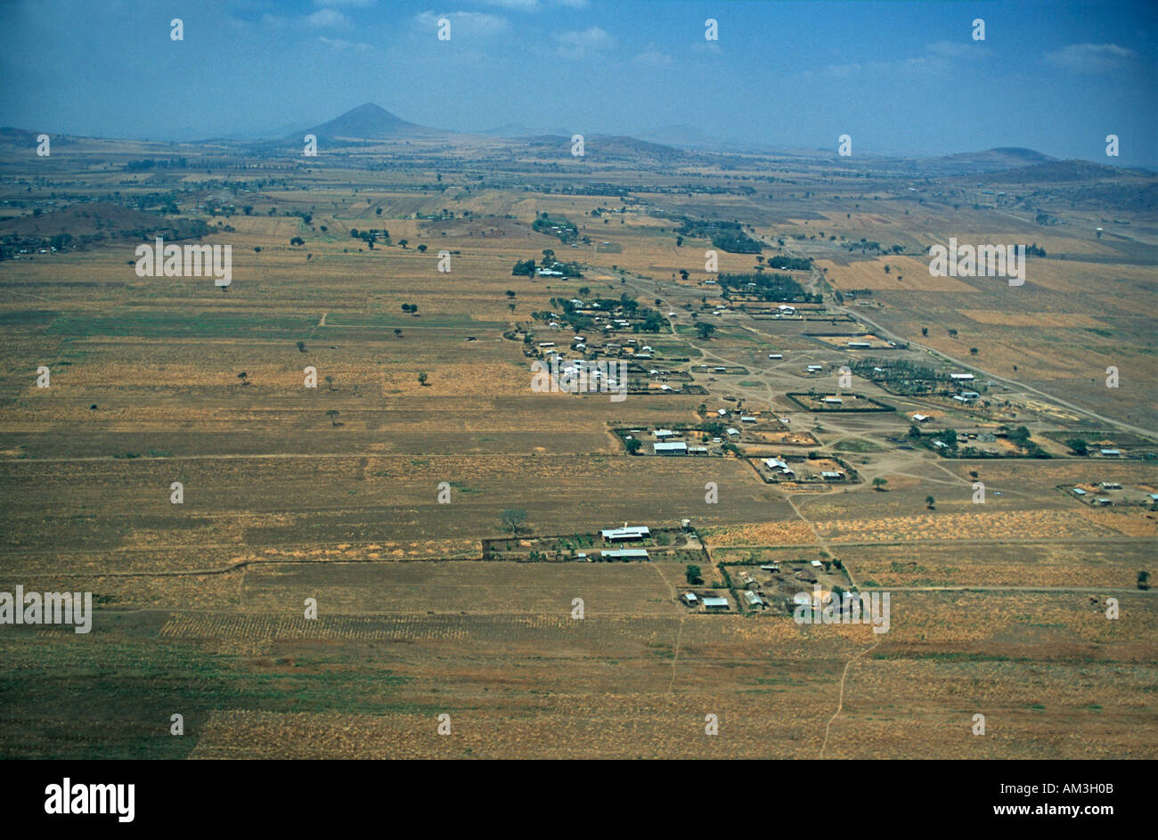 Aerial view of Masai lands on the outskirts of Arusha Approaching Arusha airport by 13 seater Cessna Tanzania East Africa - Stock Image
