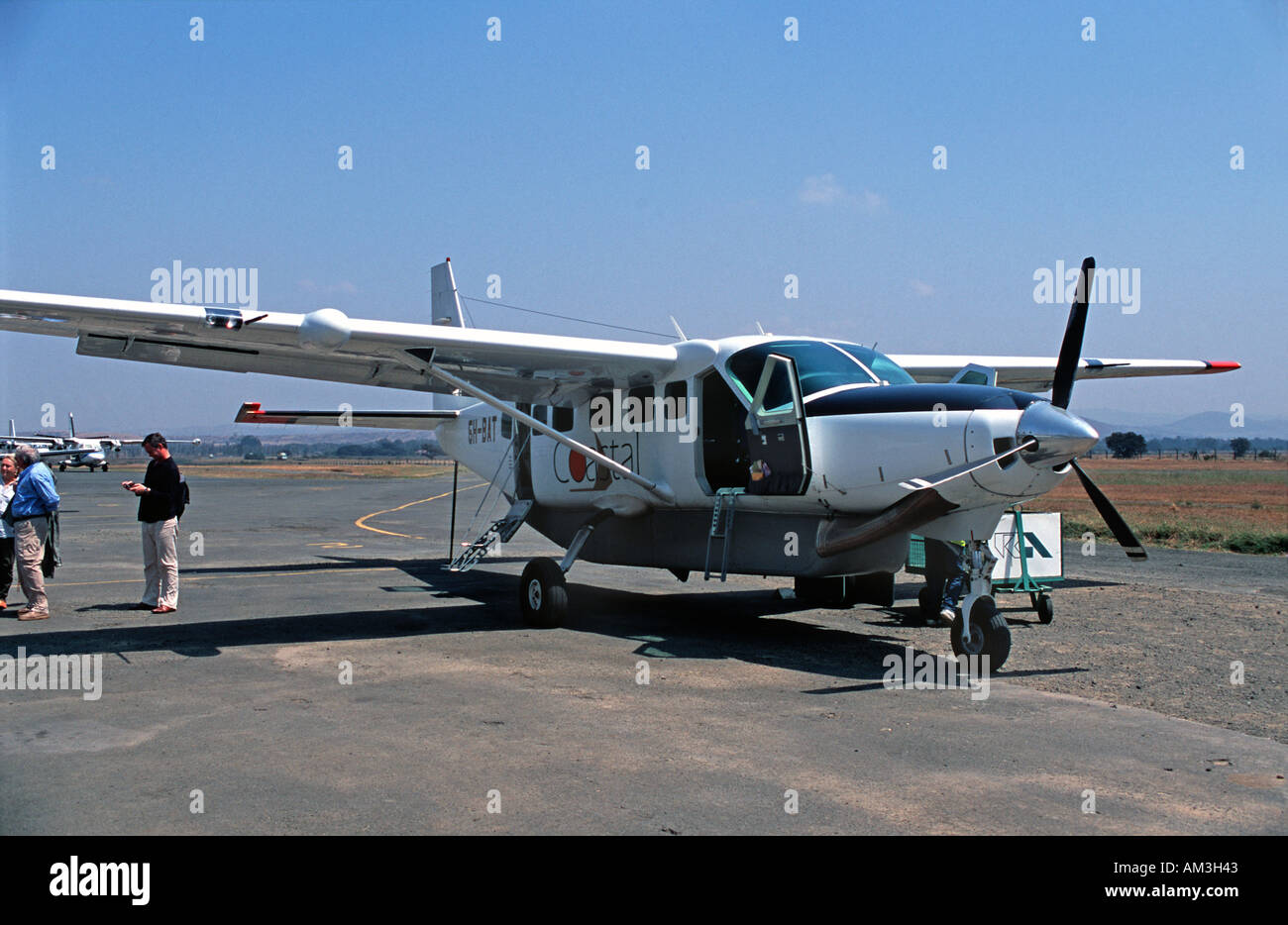 Arriving at Arusha by 13 seater single prop Cessna Northern Tanzania East Africa - Stock Image