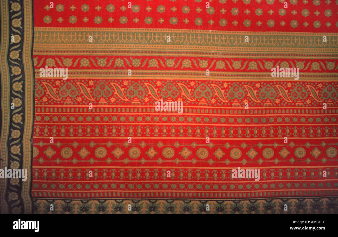 Detail of a colourful Tanzanian kanga cloth as worn by Tanzanian women Stone Town Unguja Zanzibar Tanzania - Stock Image