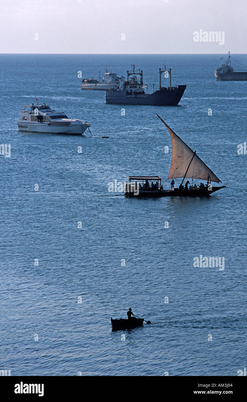 Boats in the harbour in the late afternoon Viewed from House of Wonder on Stone Towns historic waterfront Zanzibar Tanzania - Stock Image