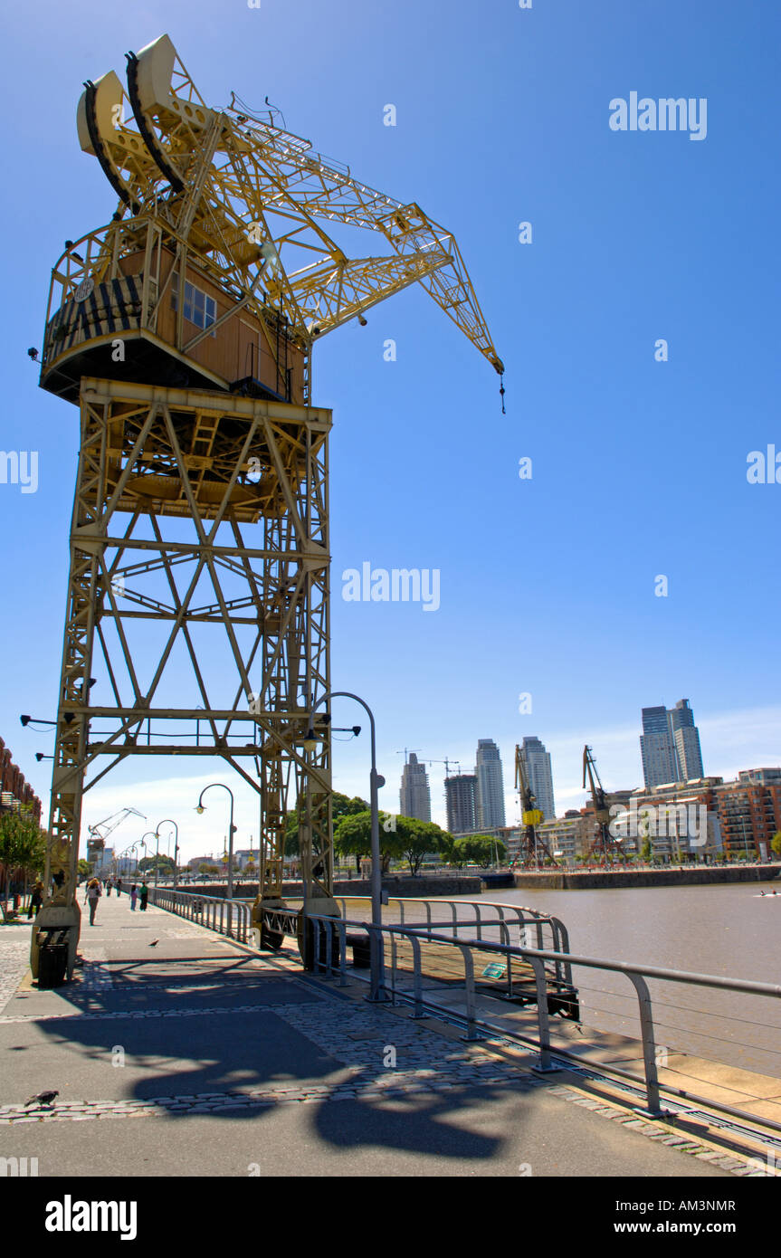 The Puerto Madero district of Buenos Aires with its docks complete with cranes now a bustling and evolving upmarket - Stock Image