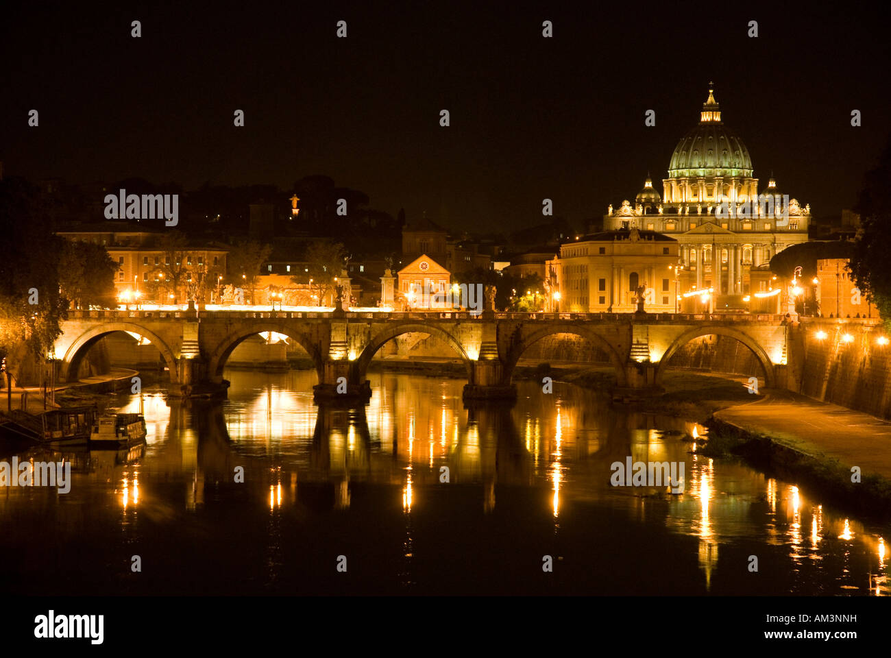 Ponte Sant Angelo bridge over the river Tiber and St Peter s Basilica the Vatican Rome Italy - Stock Image