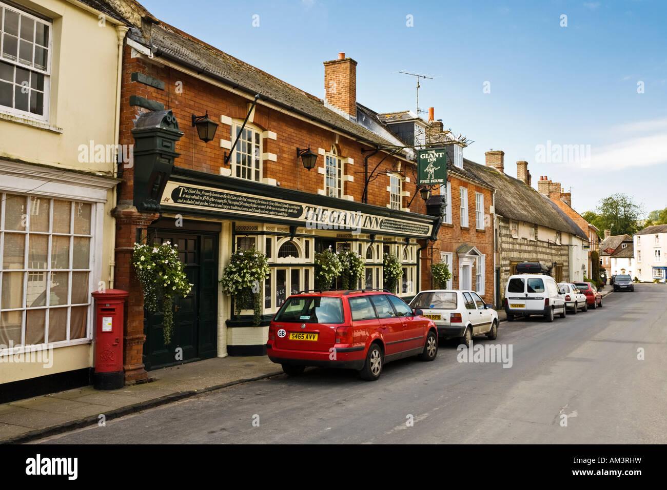 Cerne Abbas village, Dorset, UK - with the Giant Inn pub - Stock Image