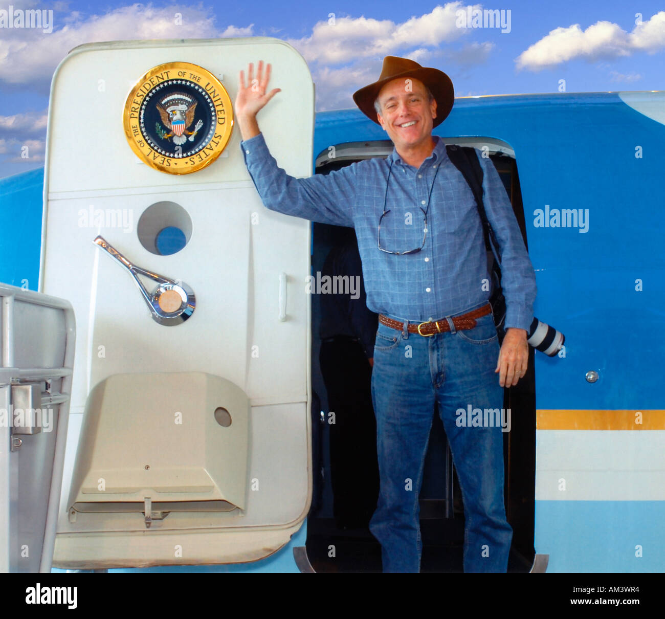 Photographer Joe Sohm posing with Air Force One on display at the Reagan Library Simi Valley CA - Stock Image