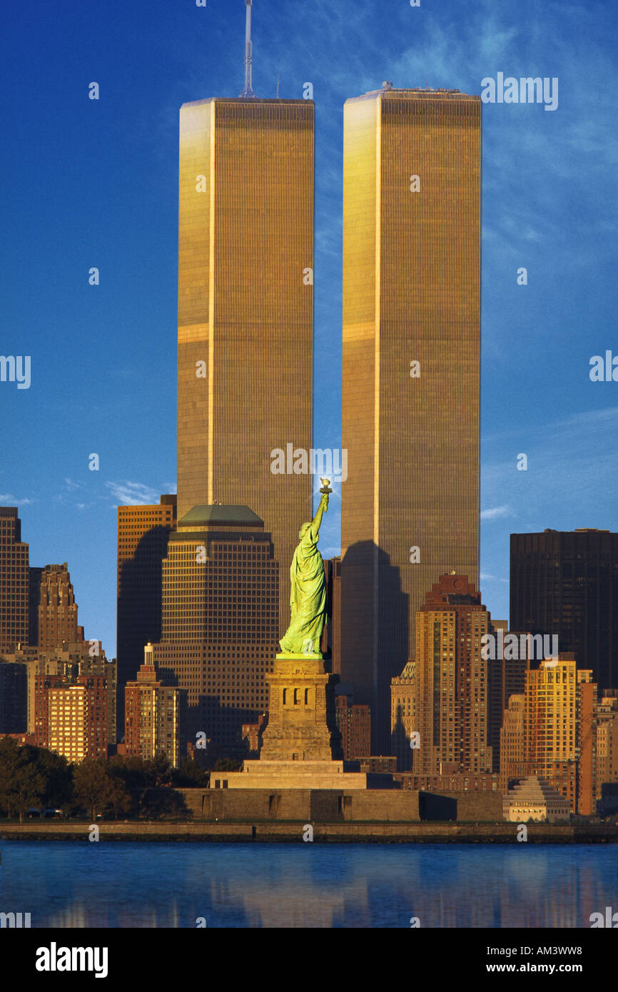 World Trade Center behind Statue of Liberty - Stock Image