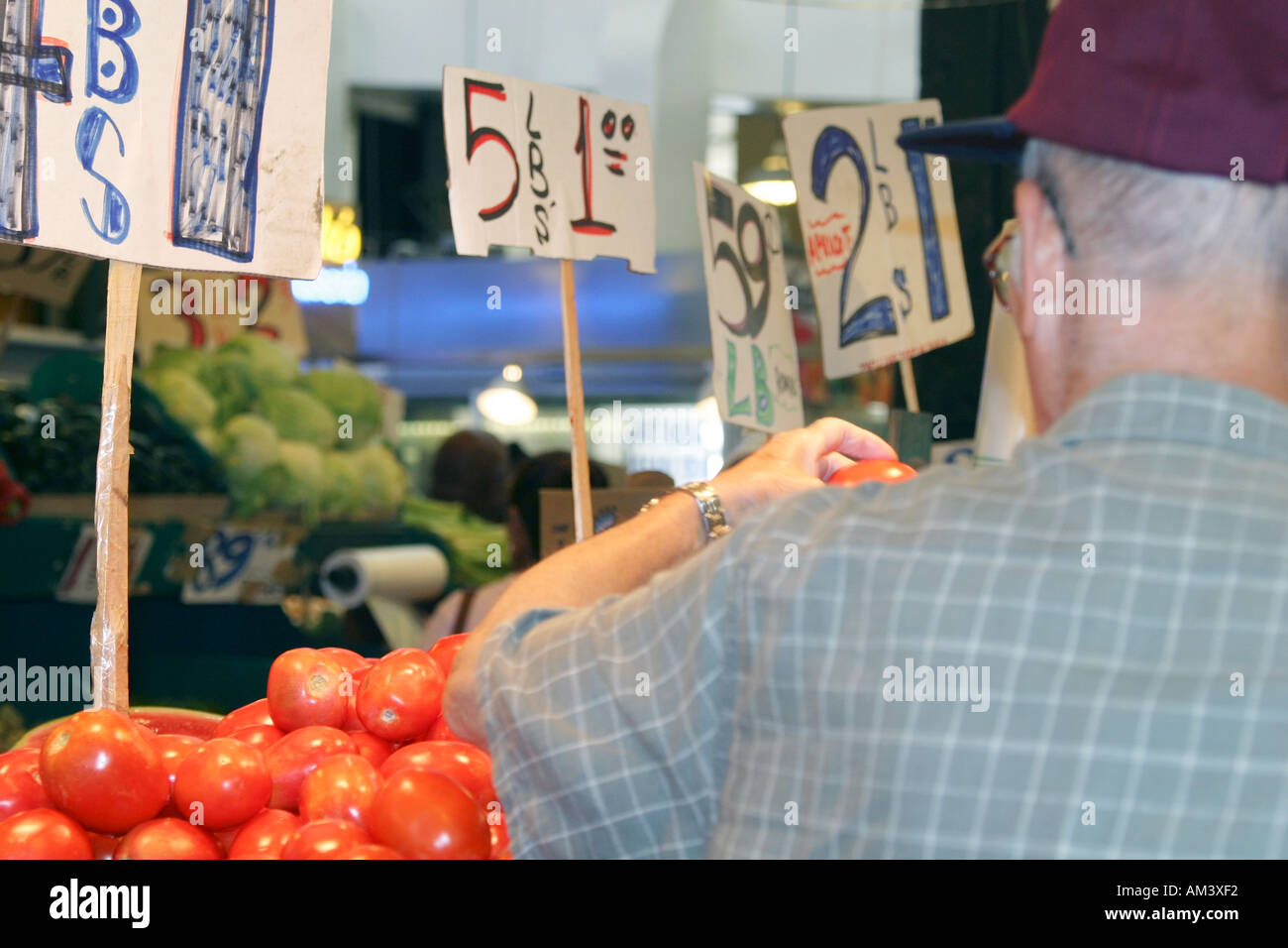Man looking at vegetables Stock Photo