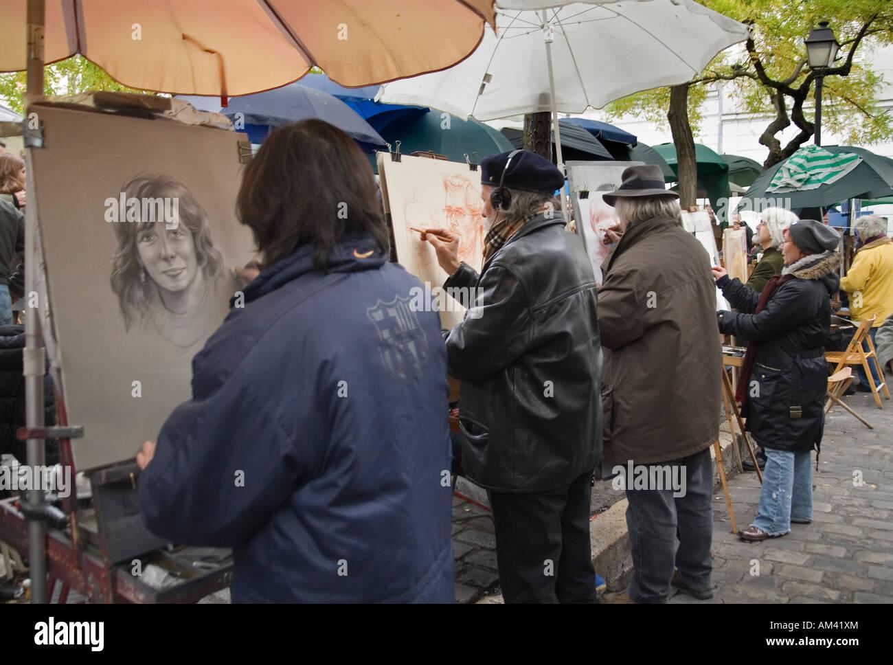 Local street painters at work at Place du Tertre Montmartre Paris France - Stock Image