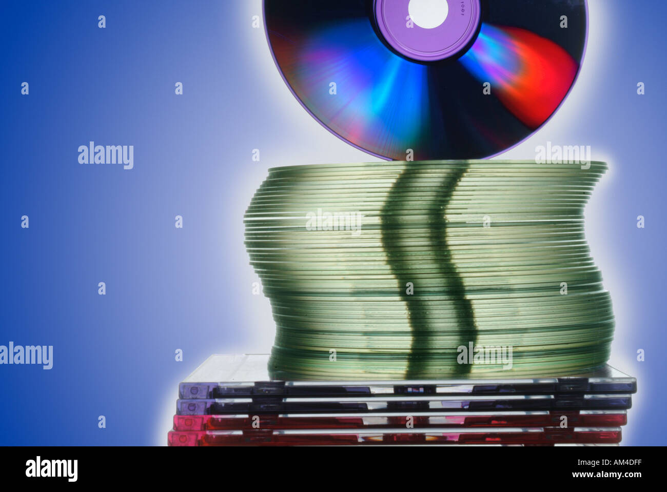 blank CD s and cases in a stack seen edge on - Stock Image