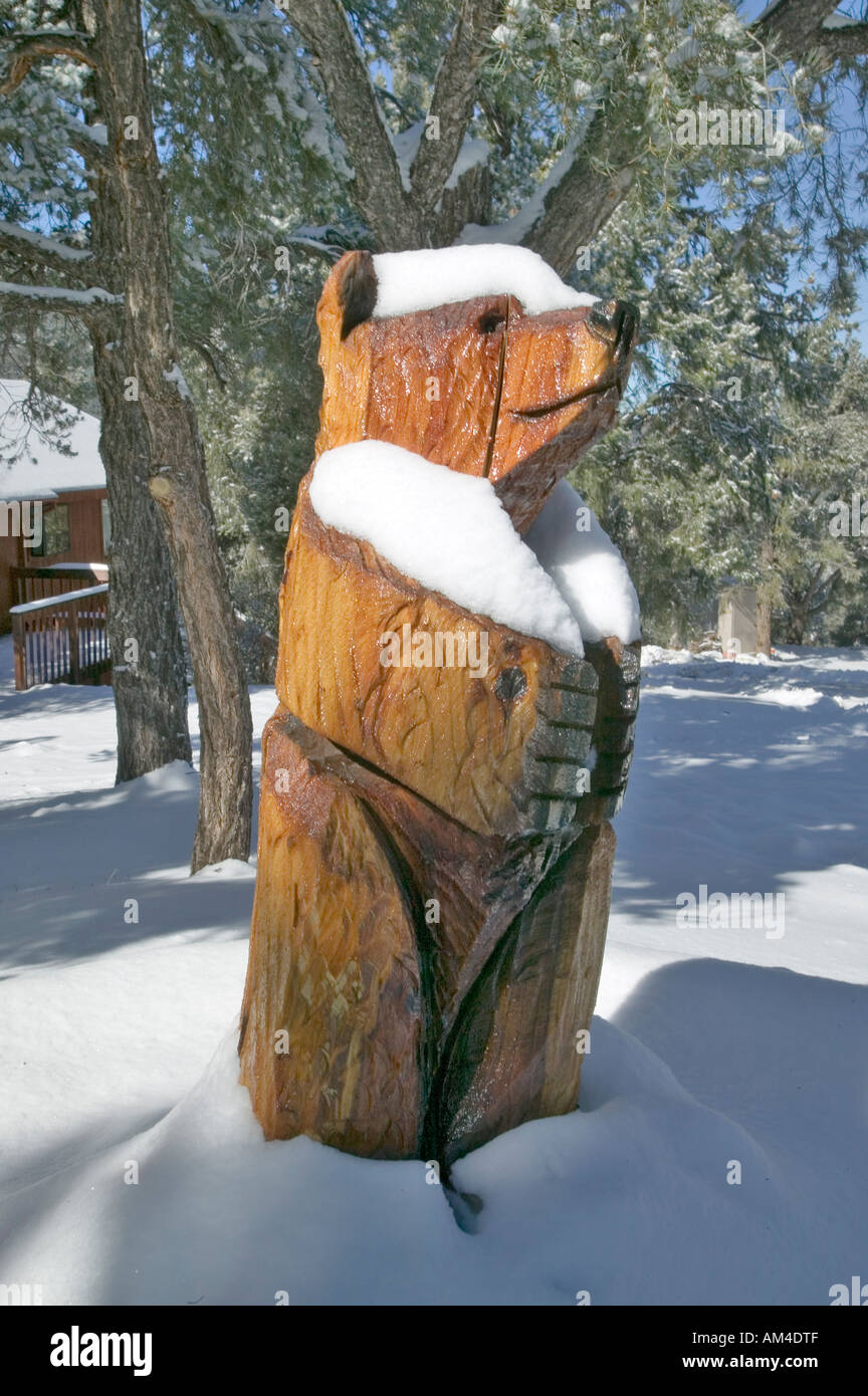 Snow on wooden Bear in Pine Mountain Club Kern County